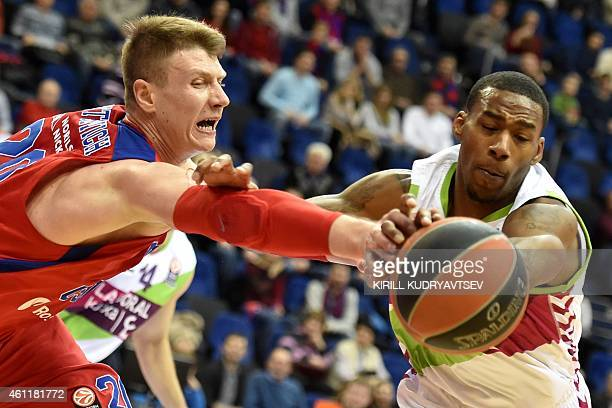 Moscow's Andrey Vorontsevich vies with Laboral Kutxa Vitoria's Darius Adams during their Euroleague Top16 group F basketball match in Moscow on...