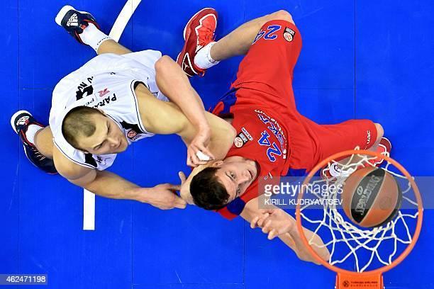Moscow's center Sasha Kaun fights for the ball with Nizhny Novgorod's Belarus center Artsiom Parakhouski during their Euroleague Top16 group F...