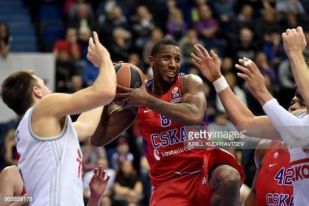 Moscow's Demetris Nichols vies with Real Madrid's Luka Doncic during their Euroleague Top 16 group F basketball match between CSKA Moscow and Real...