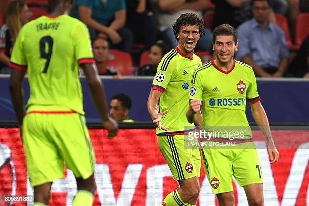 Moscow's Finnish midfielder Roman Eremenko celebrates scoring his team's second goal with his teammates during the Champions League group E firstleg...