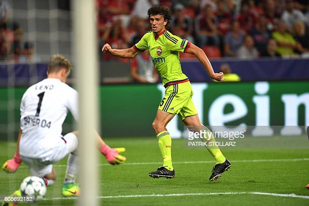 Moscow's Finnish midfielder Roman Eremenko scores his team's second goal past Leverkusen's goalkeeper Bernd Leno during the Champions League group E...