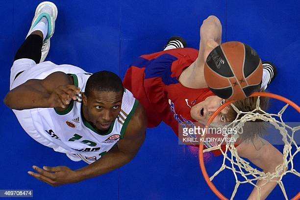 Moscow's forward Andrei Kirilenko fights for the ball with Panathinaikos Athens' US guard Demarkus Nelson during their Euroleague playoffs round 1...