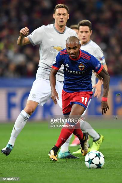Moscow's forward from Brazil Vitinho and Manchester United's midfielder from Serbia Nemanja Matic vie for the ball during the UEFA Champions League...