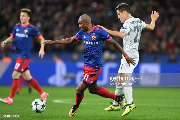 Moscow's forward from Brazil Vitinho and Manchester United's midfielder from Spain Ander Herrera vie for the ball during the UEFA Champions League...