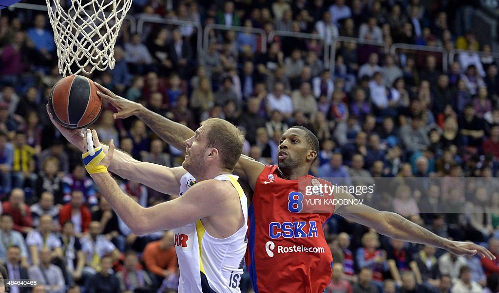Moscow's forward Nichols Demetris (R) vies with Fenerbahce Ulker's center Luka Zoric (L) during their Euroleague top 16, round 8, group F basketball match between CSKA Moscow and Fenerbahce Ulker in Moscow, on February 27, 2014.