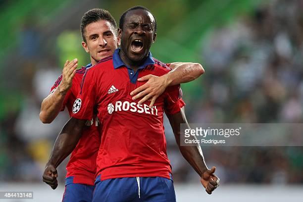 Moscow's forward Seydou Doumbia celebrates scoring a goal with PFC CSKA Moscow's midfielder Zoran Tosic during the UEFA Champions League qualifying...