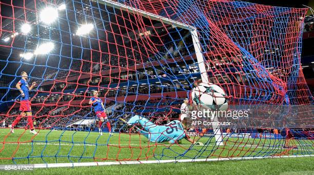 Moscow's goalkeeper from Russia Igor Akinfeev fails to stop the ball during the UEFA Champions League Group A football match between PFC CSKA Moscow...