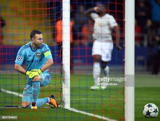 Moscow's goalkeeper from Russia Igor Akinfeev reacts after failing to stop the ball during the UEFA Champions League Group A football match between...