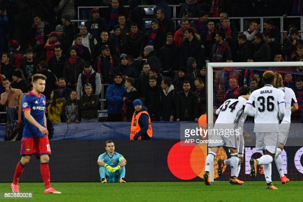 Moscow's goalkeeper from Russia Igor Akinfeev reacts as Basel's players celebrate the team's second goal during the UEFA Champions League Group A...