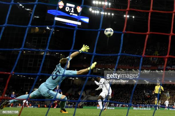 Moscow's goalkeeper from Russia Igor Akinfeev saves the ball during the UEFA Champions League Group A football match between PFC CSKA Moscow and FC...