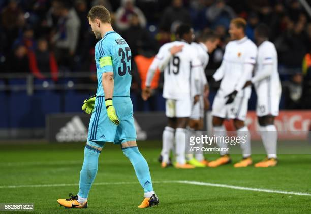 Moscow's goalkeeper from Russia Igor Akinfeev walks on the field as Basel's players celebrate the team's second goal during the UEFA Champions League...
