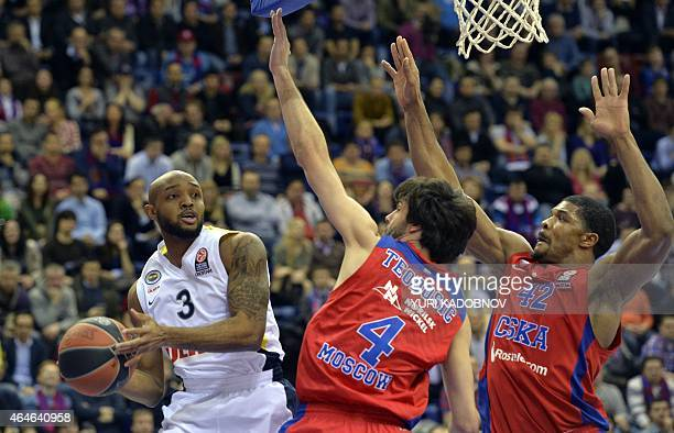 Moscow's guard Milos Teodosic and forward Kyle Hines vie with Fenerbahce Ulker's guard Ricky Hickman during their Euroleague top 16 round 8 group F...