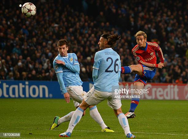 Moscow's Japanese midfielder Keisuke Honda fires a shot wide during the UEFA Champions League group D football match between Manchester City and CSKA...