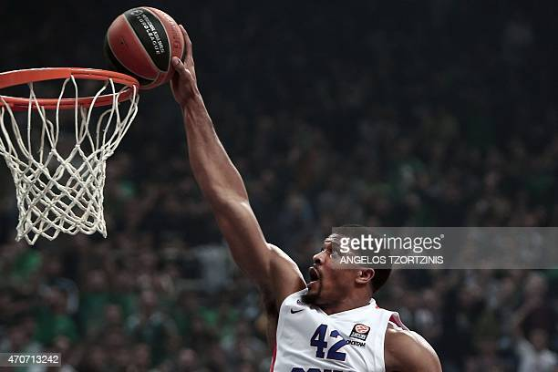 Moscow's Kyle Hines scores during the Euroleague playoff basketball match between Panathinaikos and CSKA Moscow in Athens on April 22 2015 AFP PHOTO...