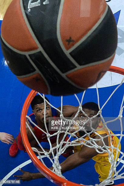 Moscow's Kyle Hines vies with FC Barcelona Lassa Shane Lawal during the Euroleague Top 16 group F basketball match between CSKA Moscow and FC...