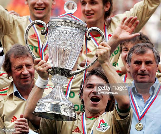 Moscow's Lokomotiv Dmitri Loskov Head coach Anatoly Bishovetz and President Yuri Semin celebrates their victory after the Russian Cup final match...