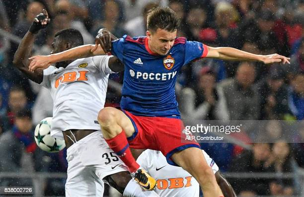 Moscow's midfielder Aleksandr Golovin vies for the ball with Young Boys' midfielder Sekou Sanogo during the UEFA Champions League play off second leg...