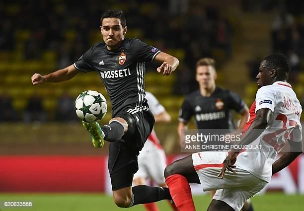Moscow's midfielder Aleksei Ionov vies for the ball with Monaco's French defender Benjamin Mendy during the UEFA Champions League Group E football...
