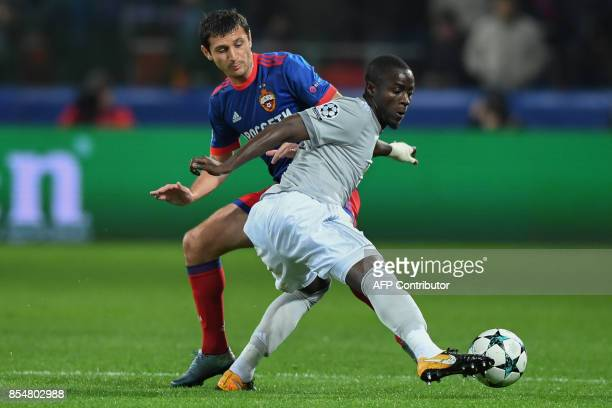 Moscow's midfielder from Russia Alan Dzagoev and Manchester United's defender from Ivory Coast Eric Bailly vie for the ball during the UEFA Champions...