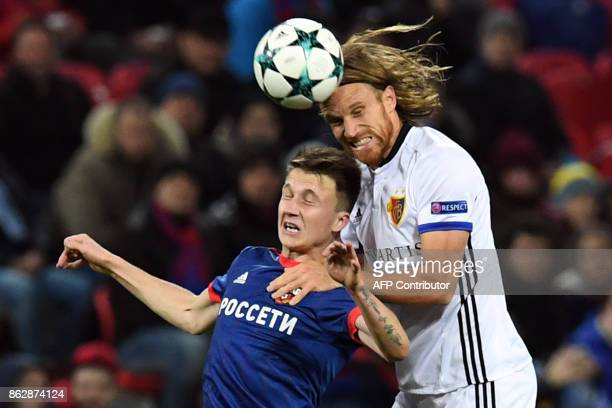 Moscow's midfielder from Russia Aleksandr Golovin and Basel's defender from Switzerland Michael Lang vie for the ball during the UEFA Champions...