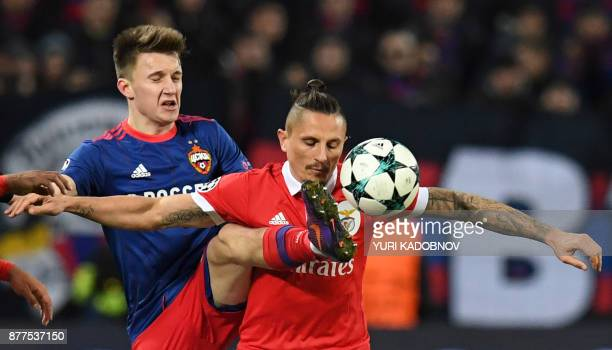 Moscow's midfielder from Russia Aleksandr Golovin and Benfica's midfielder from Serbia Ljubomir Fejsa vie for the ball during the UEFA Champions...