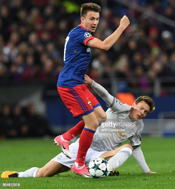 Moscow's midfielder from Russia Aleksandr Golovin and Manchester United's defender from Sweden Victor NilssonLindelof vie for the ball during the...