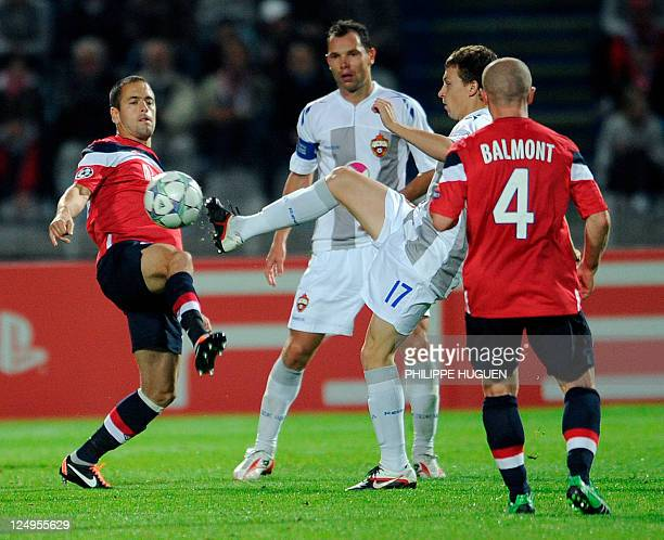 Moscow's midfielder Pavel Mamaev vies with Lille's British midfielder Joe Cole during the UEFA Champions League football match Lille vs CSKA Moscow...