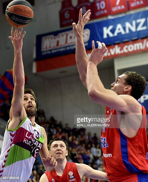 Moscow's player Sasha Kaun fights for the ball with Laboral Kutxa Vitoria's player Fernando San Emeterio during their Euroleague Top16 group F...