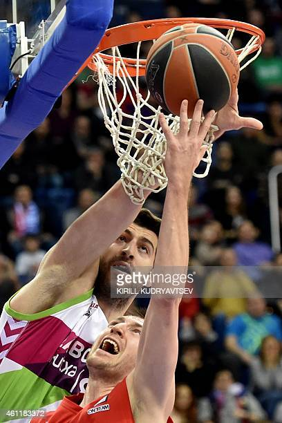 Moscow's player Vitaly Fridzon fights for the ball with Laboral Kutxa Vitoria's player Mirza Begic during their Euroleague Top16 group F basketball...