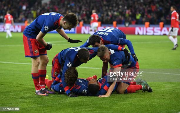 Moscow's players celebrate after Benfica's defender from Brazil Jardel scored an own goal during the UEFA Champions League Group A football match...
