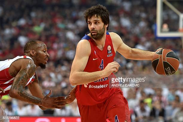 Moscow's Serbian guard Milos Teodosic vies with Crvena Zvezda Telekom Belgrade's US forward Tarance Kinsey during the Euroleague playoff basketball...