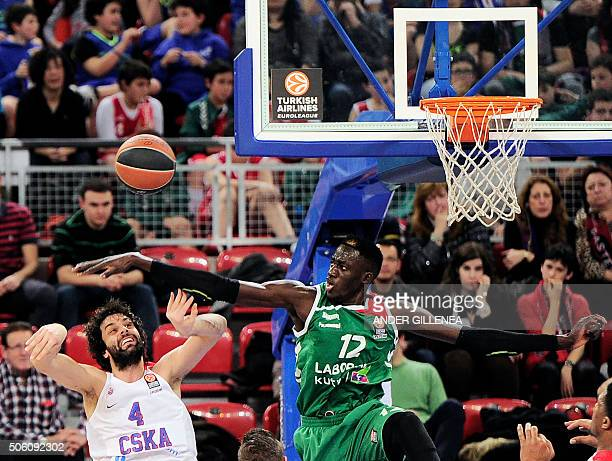 Moscow's Serbian guard Milos Teodosic vies with Laboral Kutxa's center Ilimane Diop during the Euroleague group F Top 16 round 4 basketball match...