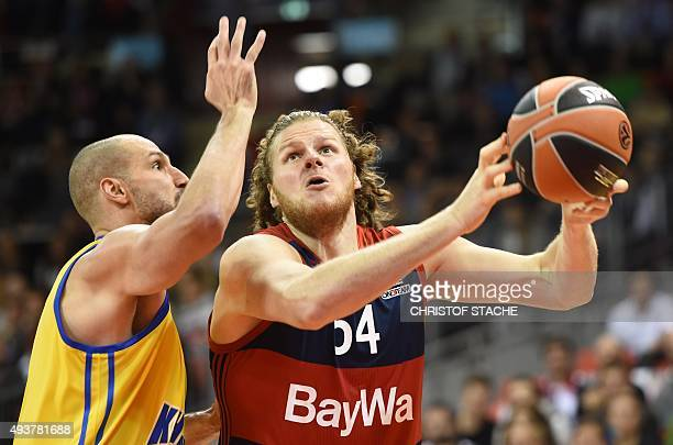 Moscow's US forward James Augustin and Bayern Munich's US center John Bryant vie for the ball during the EuroLeague Group A Basketball match FC...