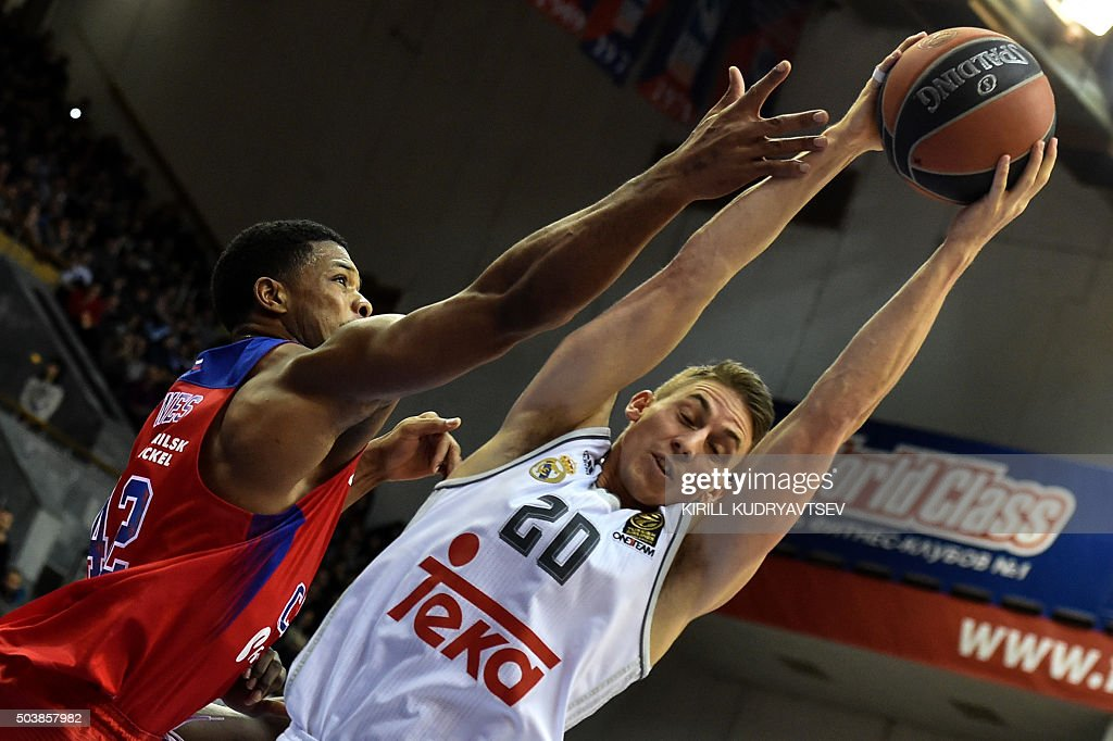 Moscow's US forward Kyle Hines vies with Real Madrid's Jaycee Carroll during their Euroleague Top 16 group F basketball match between CSKA Moscow and...