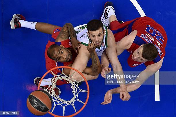 Moscow's US guard Aaron Jackson and CSKA Moscow's guard Andrey Vorontsevich fight for the ball with Panathinaikos Athens' forward Nikos Pappas during...
