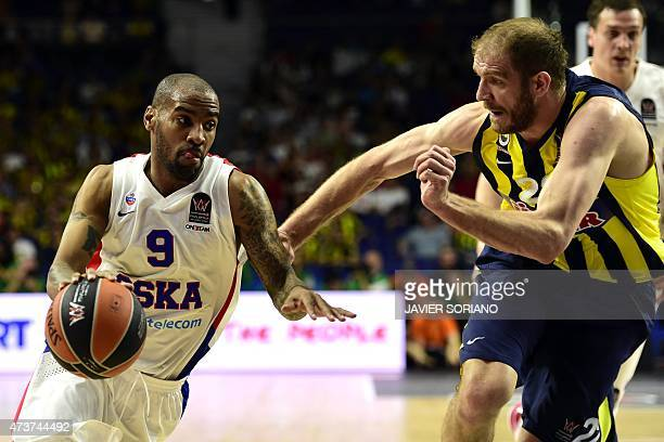 Moscow's US guard Aaron Jackson vies with Fenerbahce Ulker's Croatian center Luka Zoric during the Euroleague Final Four basketball third place game...