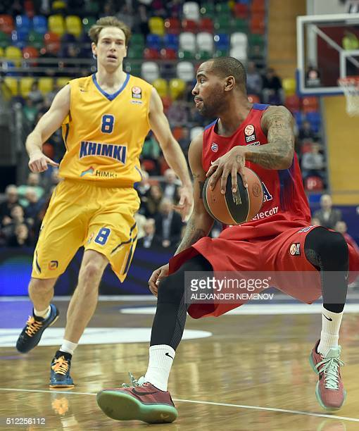 Moscow's US guard Aaron Jackson vies with Khimki Moscow Region's Finnish guard Petteri Koponen during the Euroleague group F Top 16 round 8...