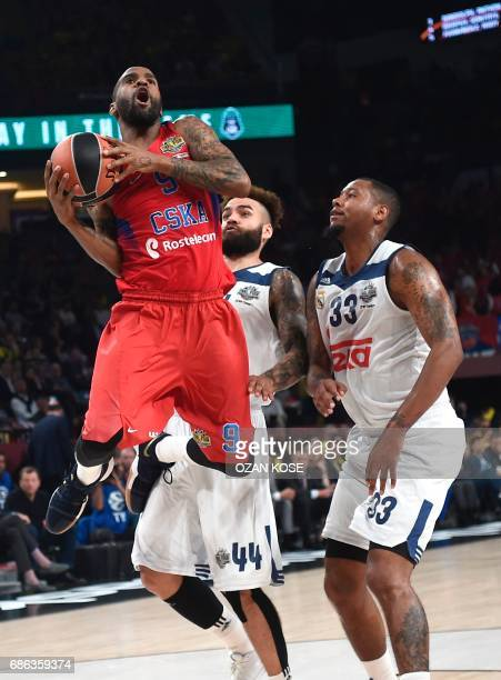 Moscow's US guard Aaron Jackson vies with Real Madrid's US forward Trey Thompkins and Swedish forward Jeffery Taylor during the third place...