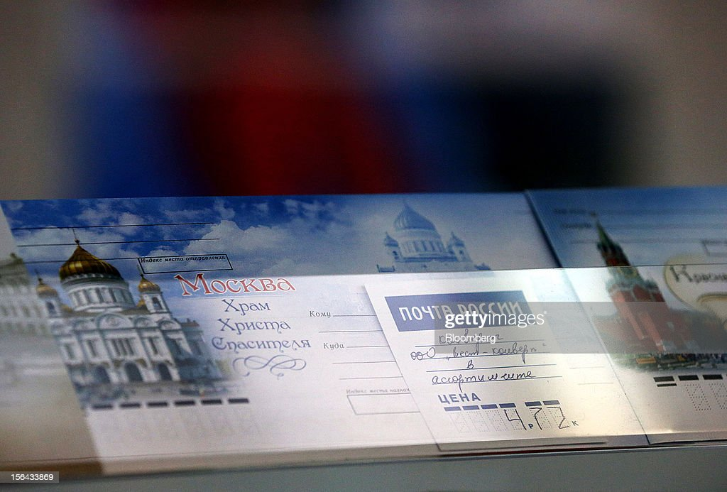 Moscow-themed envelopes sit for sale at a post office, operated by Russian Post, in Moscow, Russia, on Wednesday, Nov. 14, 2012. Alexander Kiselev, Russian Post's chief executive officer, needs to invest 200 billion rubles through 2020 to turn around a company that described its infrastructure as 'the most expansive, but the least efficient' in a strategy plan this year. Photographer: Andrey Rudakov/Bloomberg via Getty Images