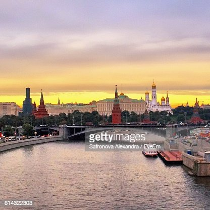 Moscva River And Buildings Against Sky During Sunset