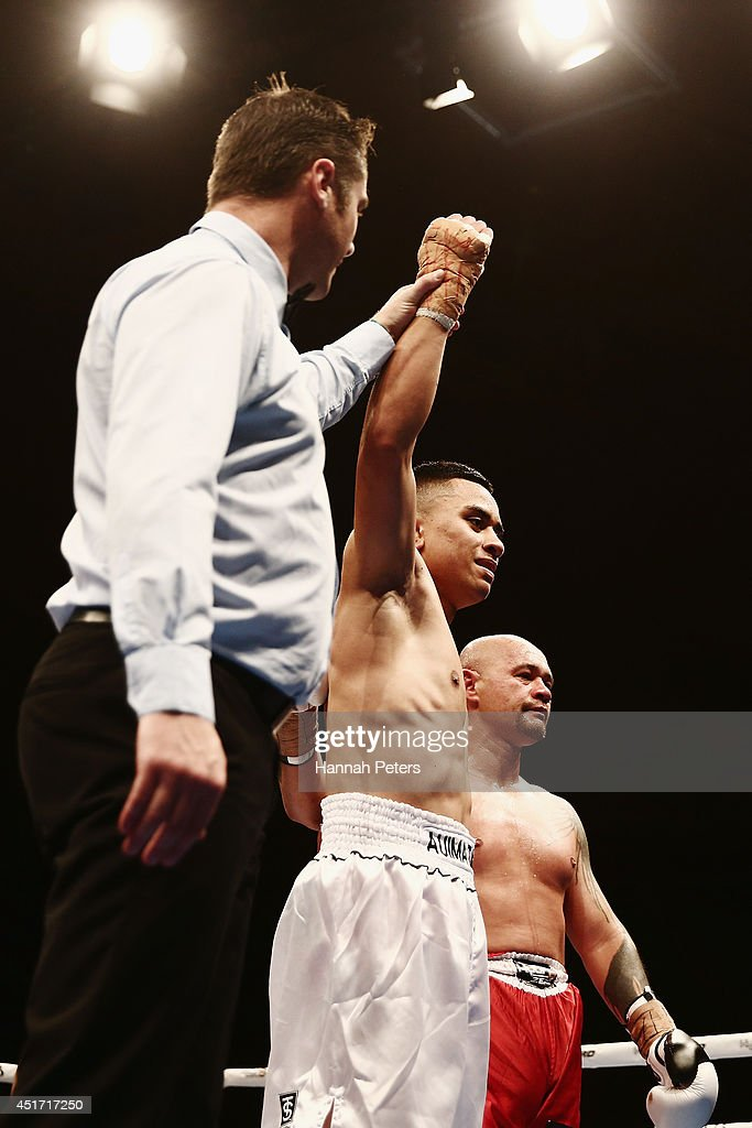 Mose Auimatagi of New Zealand celebrates after beating Jody Allen of New Zealand during fight B at Vodafone Events Centre on July 5, 2014 in Auckland, New Zealand.