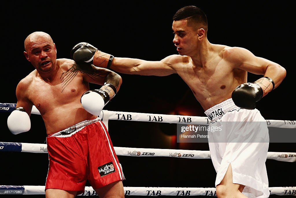 Mose Auimatagi of New Zealand fights Jody Allen of New Zealand during fight B at Vodafone Events Centre on July 5, 2014 in Auckland, New Zealand.