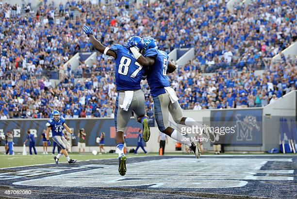 Mose Frazier of the Memphis Tigers celebrates his touchdown catch with Tevin Jones against the Missouri State Bears on September 5 2015 at Liberty...