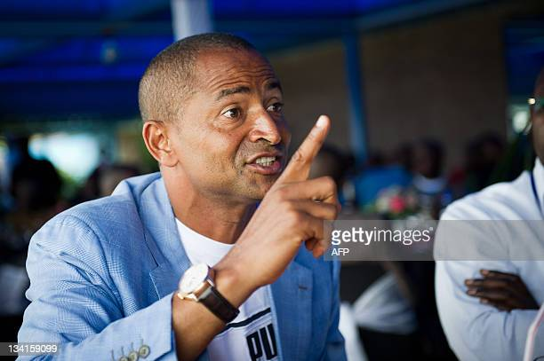 Moïse Katumbi Chapwe Governor of DR Congo's Katanga province talks with international observers at a preelection lunch in Lubumbashi on November 27...