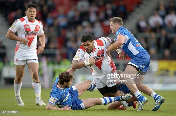 Mose Masoe of St Helens is tackled by Ben Kavanagh and Paul McShane of Wakefield Trinity Wildcats during the First Utility Super League match between...