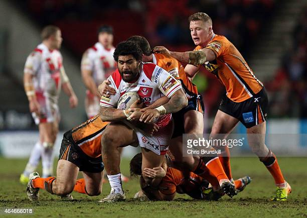 Mose Masoe of St Helens is tackled by Oliver Holmes and Grant Millington of Castleford Tigers during the First Utility Super League match between St...