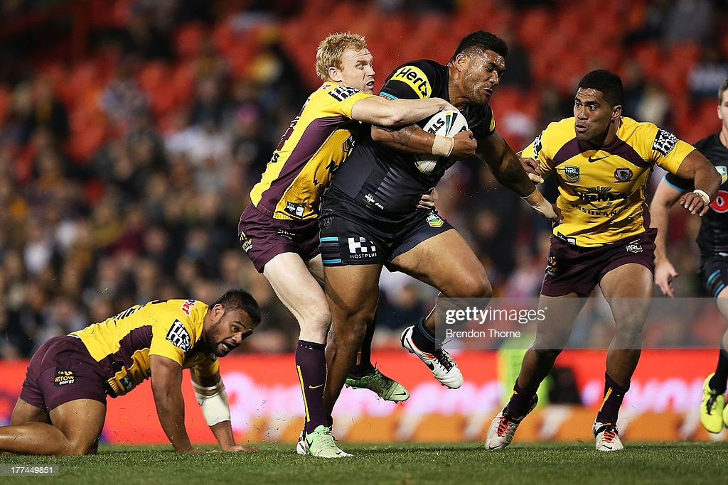 Mose Masoe of the Panthers breaks the Broncos defence during the round 24 NRL match between the Penrith Panthers and the Brisbane Broncos at Centrebet Stadium on August 23, 2013 in Sydney, Australia.