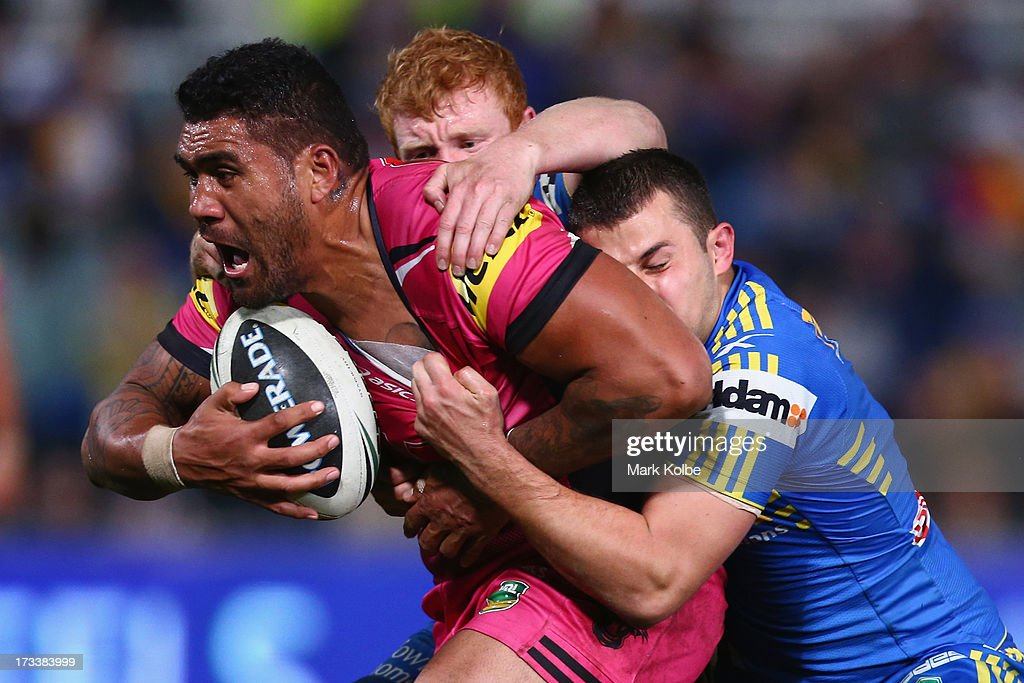 Mose Masoe of the Panthers is tackled during the round 18 NRL match between Parramatta Eels and the Penrith Panthers at Parramatta Stadium on July 13, 2013 in Sydney, Australia.