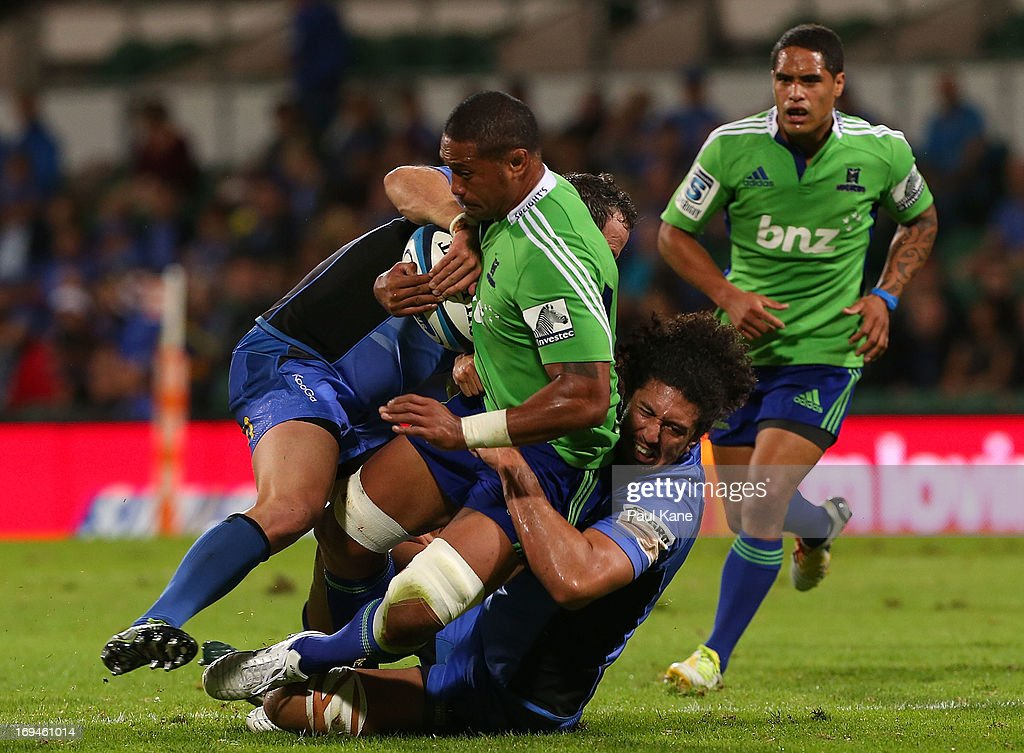 Mose Tuiali'i of the Highlanders gets tackled by Heath Tessmann and Sam Wykes of the Force during the round 15 Super Rugby match between the Western Force and the Highlanders at nib Stadium on May 25, 2013 in Perth, Australia.