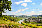View across the river Moselle to Marienburg Castle and village Punderich - Moselle valley wine region in Germany